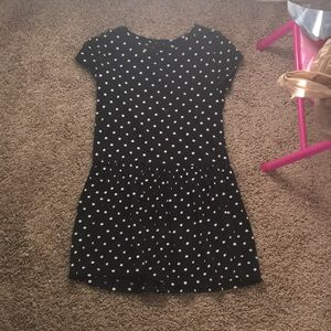 A black poke o dot dress with clip gold buttons